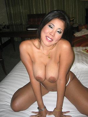 matured asian milf posing nude