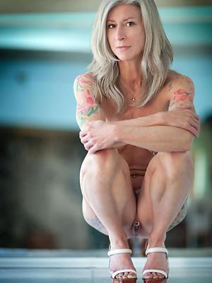 free pics of tattooed mature porn