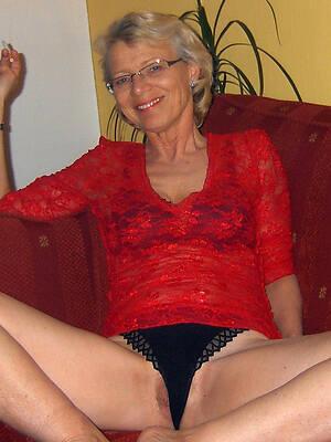 glum hot mature with glasses posing nude