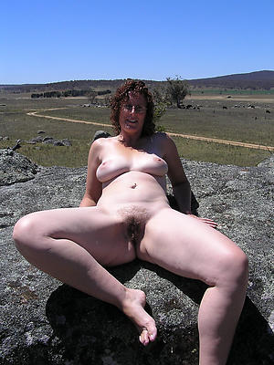 mature outdoors posing uncover