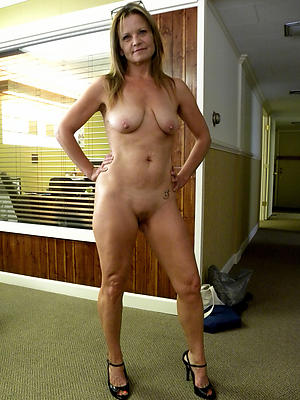 mature stockings and heels posing nude