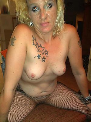 mature women on every side tattoos posing nude