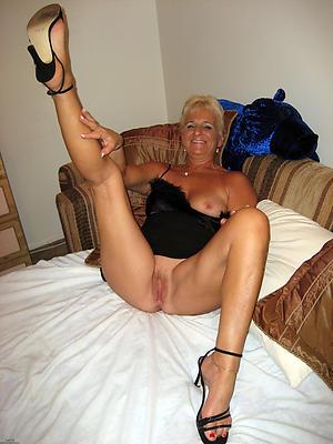 mature open legs posing nude