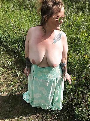 daft tattooed mature nude pics