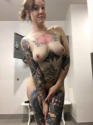 tattooed mature posing nude