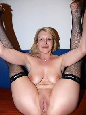 mature woman in stockings posing bald