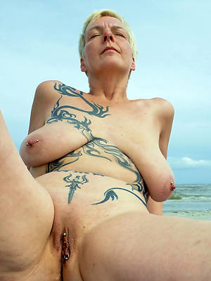 blue mature tattoo shows pussy