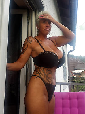 elegant nude women with tattos pictures