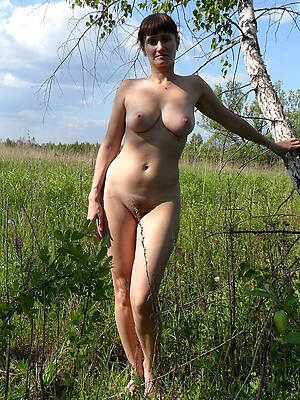 beautiful mature in one's birthday suit outdoors photos